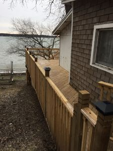 New wraparound deck w stairs to water & dock. Dock will be painted in Sp 19.