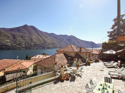 Photo for Enjoy gorgeous views of Lake Como from the private terrace of this lovely villa!