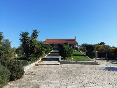 Photo for Seafront cottage with orchard and garden