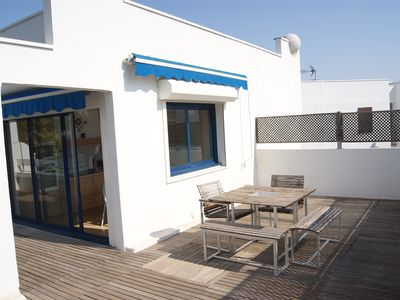Photo for 41m2 terrace! Close to the beach, pond and golf.