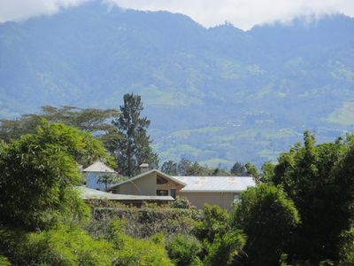 Lower left roof is house, Irazu volcano in background (telefoto exaggerates)