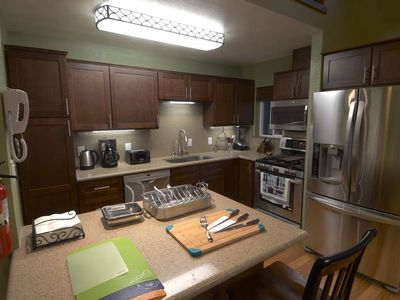 Kitchen is fully equipped with appliances, dinnerware and accessories