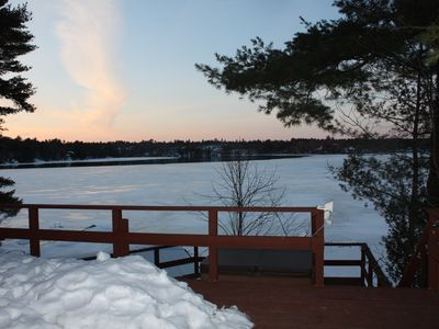 Photo for Renovated Lake front cottage with outdoor hot tub and open wood fire place