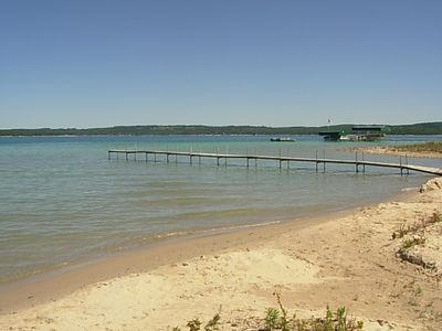 Photo for 250 feet of sandy beach on Lake Charlevoix