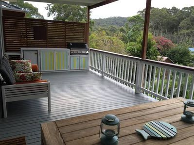 Our back deck with bar fridge, dart board, gas BBQ and the all important day bed