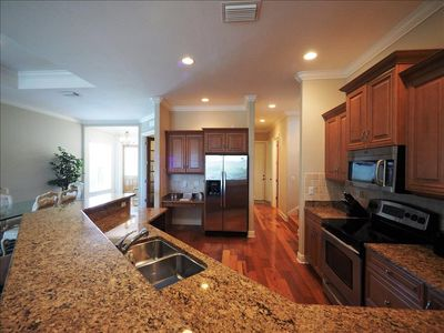 Photo for Naples Luxury Beach House -4 bedroom plus sleeping den - Heated Pool and Spa