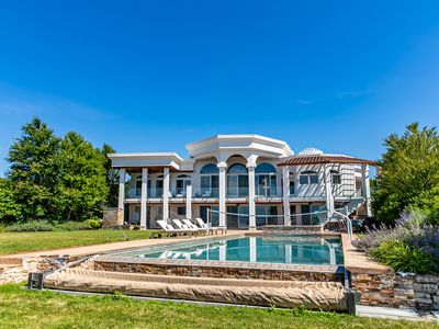 Photo for Gorgeous luxury lakefront pool house - amazing views, hot tub, outdor fireplace