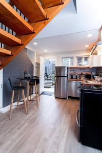 The downstairs contains a small living space, and well appointed kitchen.