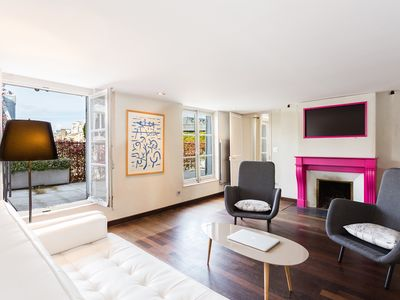 Photo for Spacious apartment with private terrace just steps from the Champs Elysees