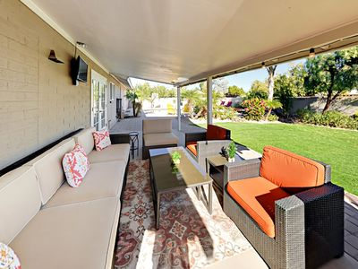 Backyard - Hang out on the covered patio, where a lounge area provides seating for 6 and a flat-screen TV.