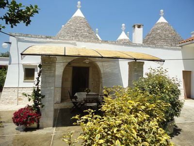 Photo for Renovated holiday cottage - cluster of historic trulli