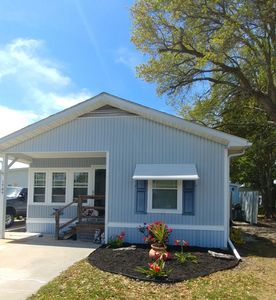 Photo for Cute 3 br/2 bath dog friendly get away! Golf cart included! 2 mins to beach!