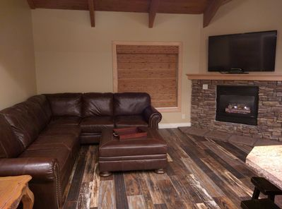 Living room with leather sectional and gas fireplace