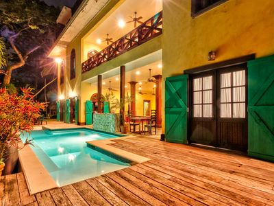 Photo for Tropical, riverfront retreat with shared pool & balcony - ideal for day trips!