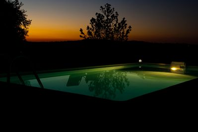 Summer poolside at night.