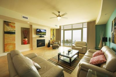"""Living room seen from kitchen area. 50"""" TV with BOSE solo sound system."""