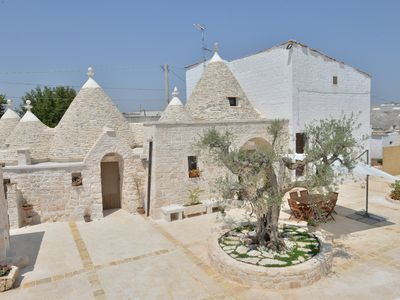Photo for Truly Trulli: Complex of renovated trulli among olive trees