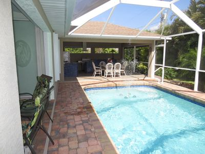 The pool area looking into the outdoor kitchen