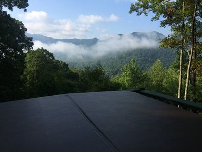 Relax and enjoy the beautiful view of the mountains in your private hot tub.