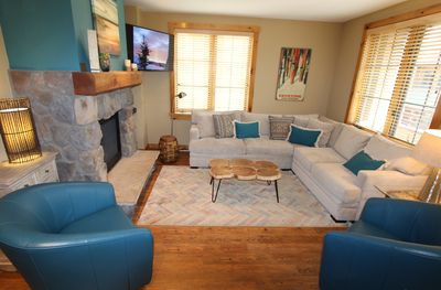 Spacious den has a sectional sofa, 2 chairs and smart TV.  Lots of room to relax