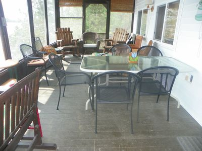 Enter enclosed porch from common area -no steps. Enjoy rockers, seating & dining