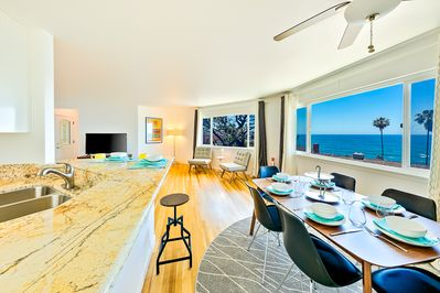 Ocean view dining area for 6 and breakfast bar with high-top stools so everyone can eat together.