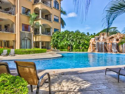 Photo for Tropical resort escape with a shared pool, ocean views, and easy beach access