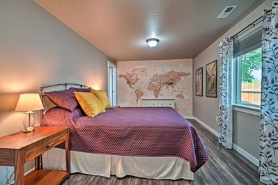 Both bedrooms feature a queen-sized bed & unique decor.