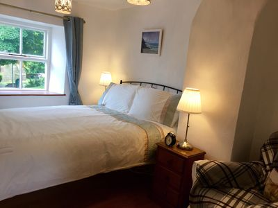 The main bedroom, with a lovely view of the 13th century chapel opposite.