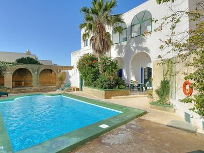 Photo for 3 bedroom Villa, sleeps 5 with Pool, Air Con and Walk to Shops