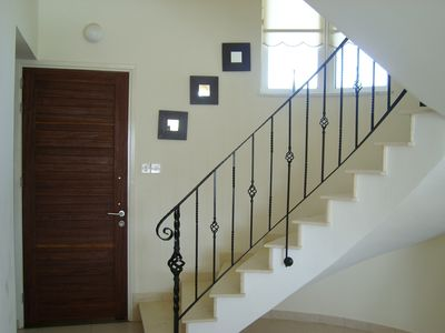 Front Door and spiral wrought iron stairway