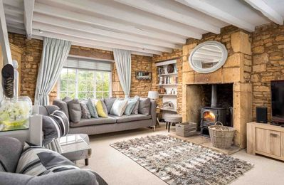 Photo for Knoll Cottage is a beautiful Cotswold stone cottage, stylishly refurbished with countryside views