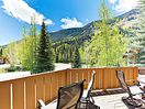 Deck - Unwind on a private deck, set before a backdrop of tree-dotted mountains.