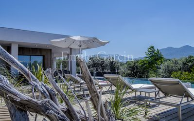 Photo for Modern villa, Air conditioned, heated pool, walking distance from the beach