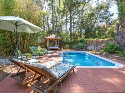 Photo for Your Own Private Backyard Oasis features a Heated Saltwater Pool, Lush Landscaping and More!