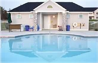 Pool Cabana with showers and changing rooms, heated swimming pool and sun deck.