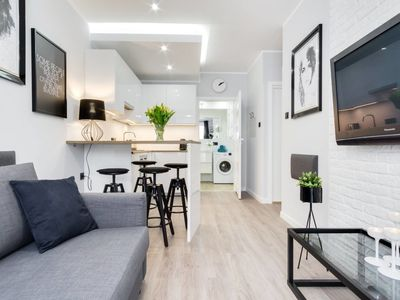 Photo for Modern apartment close to the Old Town