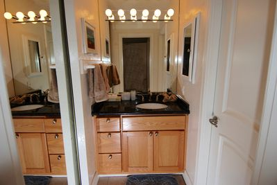 Master Bath Vanity, closet to left, toilet & shower room to right. Hairdryer too