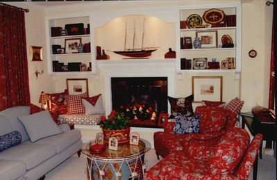 This home exemplifies summer cottage style, mixing comfy furniture with antiques