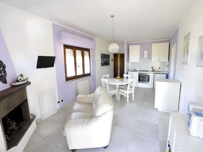Photo for Cozy apartment with large garden and swimming pool 1 km from the sea