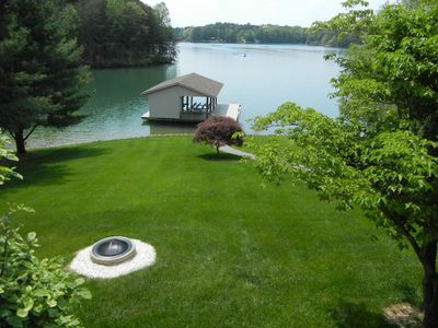 Gentle slope, Deep water wide cove, Beautiful landscaping, Fire pit.