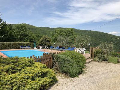 Photo for Nice apartment in villa with WIFI, pool, TV, balcony, panoramic view, parking, close to Cortona