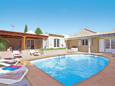 Photo for 3 bedroom Villa, sleeps 5 in Puerto del Carmen with Pool, Air Con and WiFi