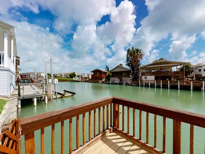 Photo for NEW LISTING! Dog-friendly, waterfront getaway w/ a dock, shared pool, & hot tub
