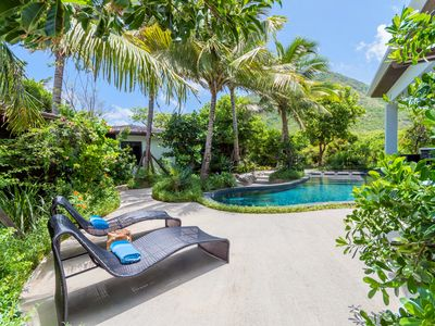 Photo for An inviting courtyard, heightened by lush private gardens.