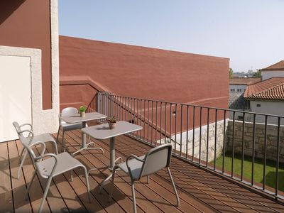 Photo for Porto Sunny Flat with Balcony apartment in Sé with private terrace.