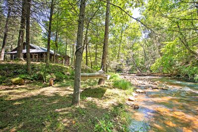 A quarter-mile trout fishing stream lies just 15 steps from the door.