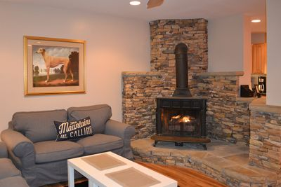 Living room with handcrafted mountain hearth and gas fireplace
