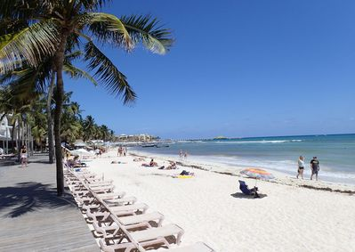 Nearly 250 feet of beachfront with complimentary lounge chairs and umbrellas
