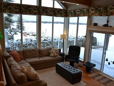 Amazing view of the lake - floor to ceiling windows - stone field fire place
